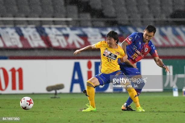 Naoki Ishihara of Vegalta Sendai controls the ball under pressure of Jang Hyun Soo of FC Tokyo during the JLeague J1 match between FC Tokyo and...