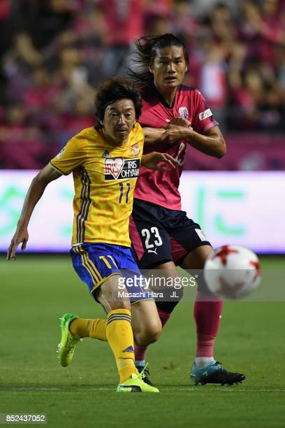 Naoki Ishihara of Vegalta Sendai controls the ball under pressure of Tatsuya Yamashita of Cerezo Osaka during the JLeague J1 match between Cerezo...