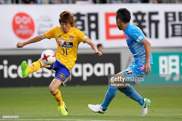 Naoki Ishihara of Vegalta Sendai takes on Takeshi Aoki of Sagan Tosu during the JLeague J1 match between Sagan Tosu and Vegalta Sendai at Best...