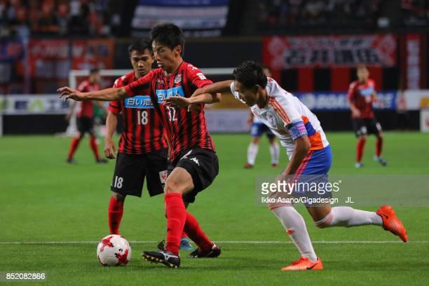 Naoki Ishikawa of Consadole Sapporo controls the ball under pressure of Kei Koizumi of Albirex Niigata during the JLeague J1 match between Consadole...