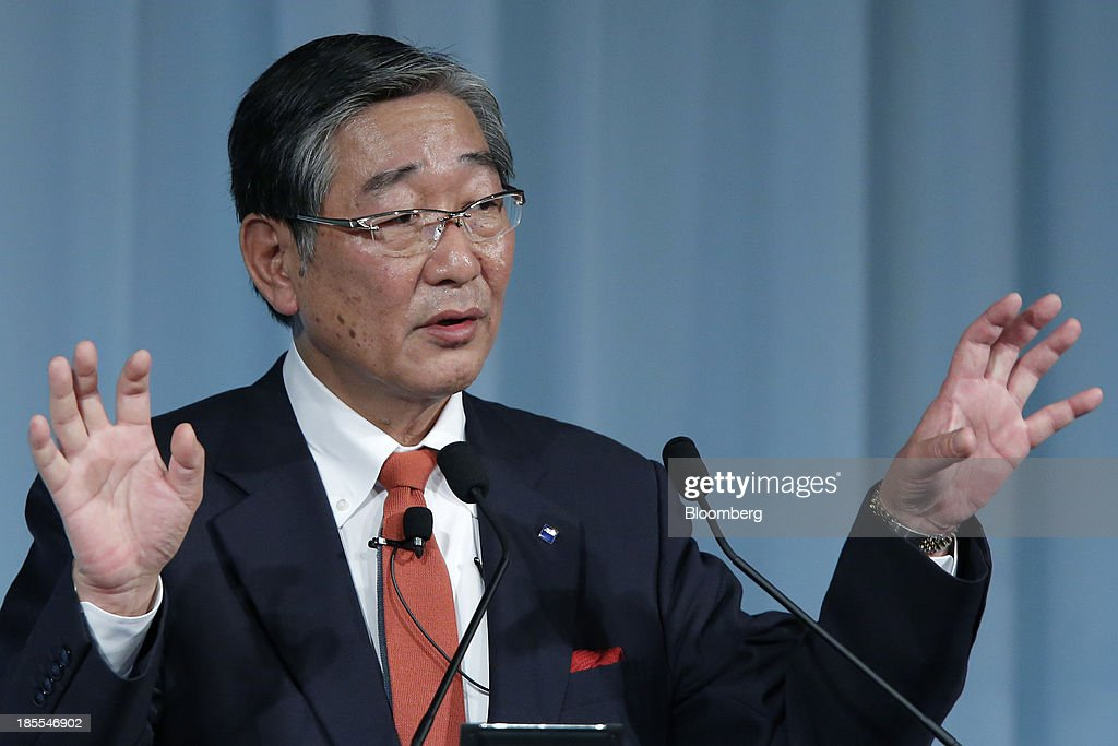 Naoki Izumiya, president and chief operating officer of Asahi Group Holdings Ltd., gestures as he speaks at the 15th Nikkei Global Management Forum in Tokyo, Japan, on Tuesday, Oct. 22, 2013. The forum concludes today. Photographer: Kiyoshi Ota/Bloomberg via Getty Images