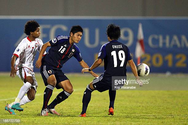 Naoki Kawaguchi and of Japan and W Ambar of UAE compete for the ball during the AFC U19 Championship Group A match between the United Arab Emirates...