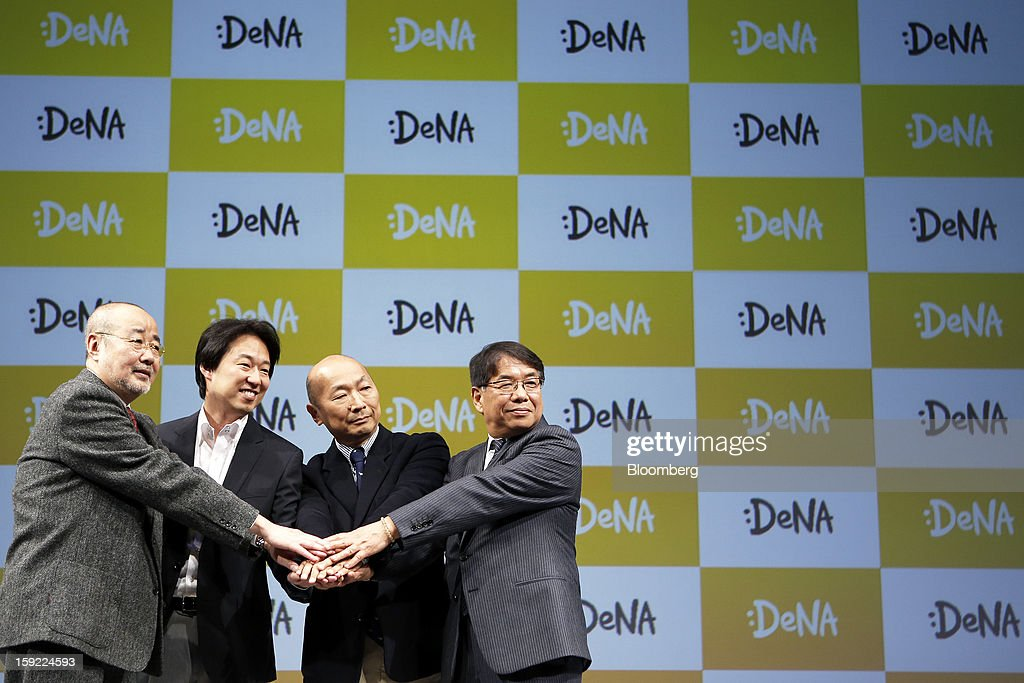 Naoki Kitagawa, chief executive officer of Sony Music Entertainment Japan Inc., from left, Isao Moriyasu, president of DeNA Co., Kazuhiko Koike, president and chief executive officer of Universal Music LLC, and Masaaki Saito, president of Victor Entertainment Inc., pose during a news conference in Tokyo, Japan, on Thursday, Jan. 10, 2013. DeNA will offer music services for iOS and Android platforms within this fiscal year, according to a statement today. Photographer: Kiyoshi Ota/Bloomberg via Getty Images