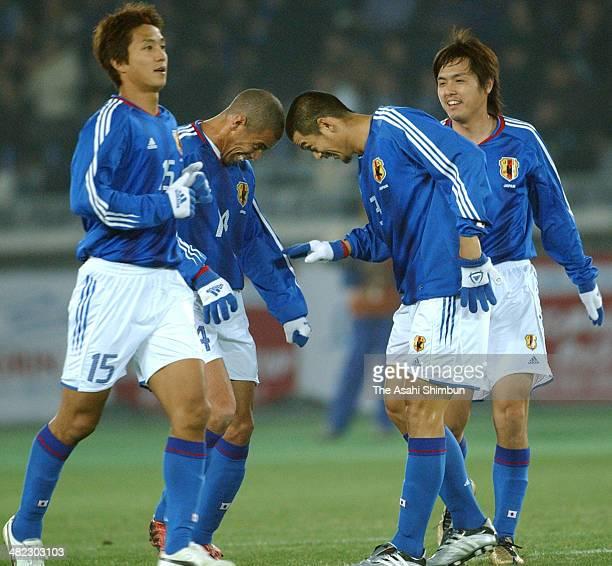 Naoki Matsuda of Japan celebrates scoring his team's second goal with his teammates Takashi Fukunishi Alessandro Santos and Yasuhito Endo during the...