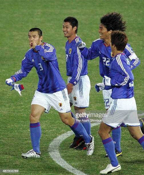 Naoki Matsuda of Japan celebrates scoring his team's second goal with his teammates Mitsuo Ogasawara Yuji Nakazawa and Takashi Fukunishi during the...