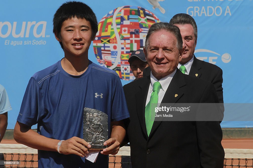 Naoki Nakawaga of Japon and Gaston Villegas, President of the Federation Mexican de Tennis during the Mexican Youth Tennis Open at Deportivo Chapultepec on December 29, 2012 in Mexico City, Mexico.