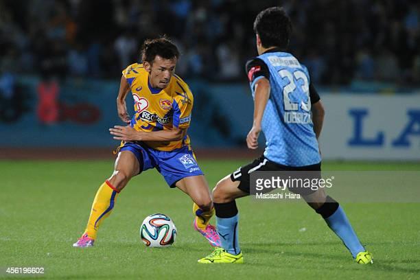 Naoki Sugai of Vegalta Sendai in action during the JLeague match between Kawasaki Frontale and Vegalta Sendai at Todoroki Stadium on September 27...