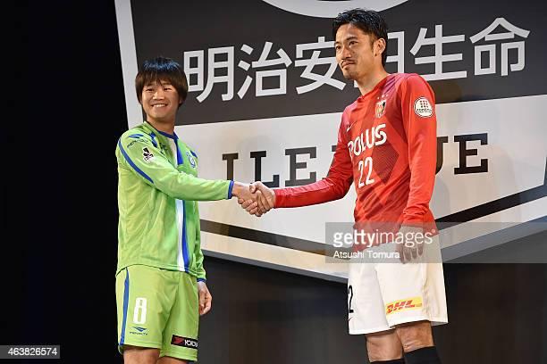 Naoki Yamada of Shonan Bellmare and Yuki Abe of Urawa Reds shake hands during the 2015 J League Press Conference at Grand Prince Hotel Shin Takanawa...
