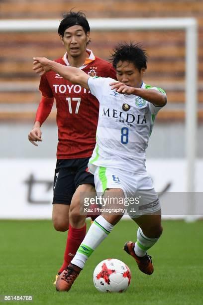 Naoki Yamada of Shonan Bellmare and Yuki Kobayashi of Nagoya Grampus compete for the ball during the JLeague J2 match between Nagoya Grampus and...