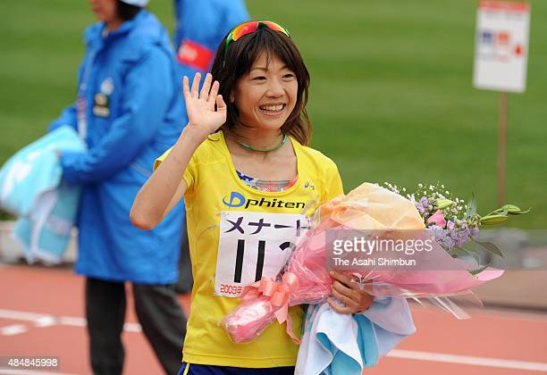 Naoko Takahashi applauds crowds after the Nagoya International Women's Marathon at Mizuho Athletic Stadium on March 8 2009 in Nagoya Aichi Japan