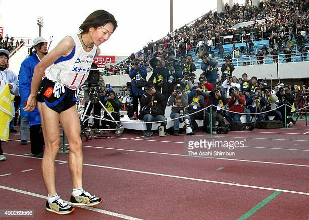Naoko Takahashi bows after the Nagoya International Women's Marathon at Mizuho Athletic Stadium on March 9 2008 in Nagoya Aichi Japan