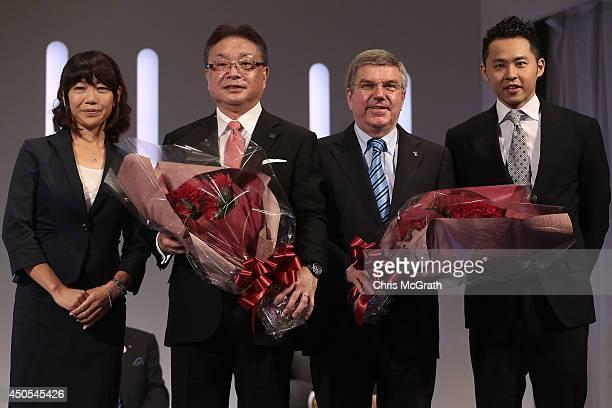 Naoko Takahashi Bridgestone CEO Masaaki Tsuya President of International Olympic Committee Thomas Bach and Kosuke Kitajima pose for a photo during a...