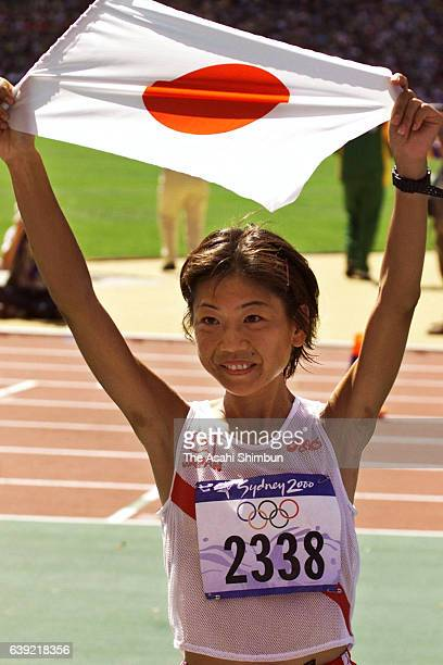Naoko Takahashi of Japan celebrates winning the gold medal after the Women's Marathon during the Sydney Olympics at Stadium Australia on September 24...