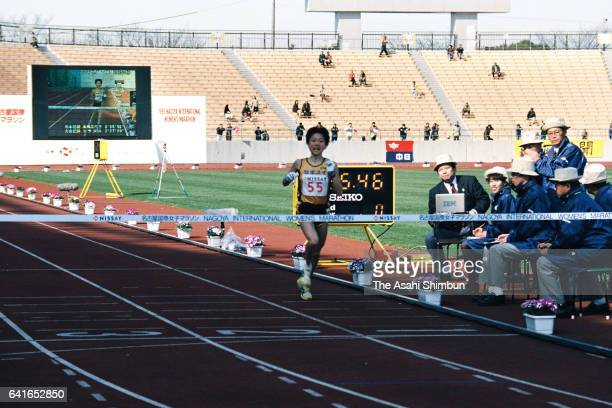 Naoko Takahashi of Japan crosses the finish line to win the 19th Nagoya International Women's Marathon at Mizuho Athletic Stadium on March 8 1998 in...