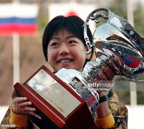 Naoko Takahashi of Japan lifts the trophy after winning the 19th Nagoya International Women's Marathon at Mizuho Athletic Stadium on March 8 1998 in...