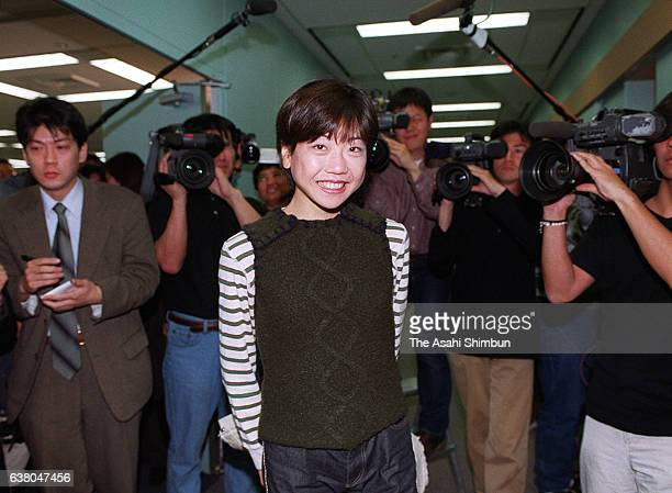 Naoko Takahashi poses for photographs during a press conference after the Japanese marathon runners for the Sydney Olympic Games announced on March...