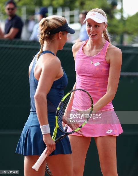 Naomi Brady of Great Britain and partner Maria Sanchez of The United States speak during the ladies doubles first round match against YungJan Chan of...