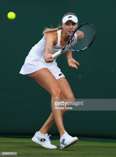 Naomi Broady of Great Britain plays a backhand during the Ladies Singles first round match against IrinaCamelia Begu of Romania on day one of the...