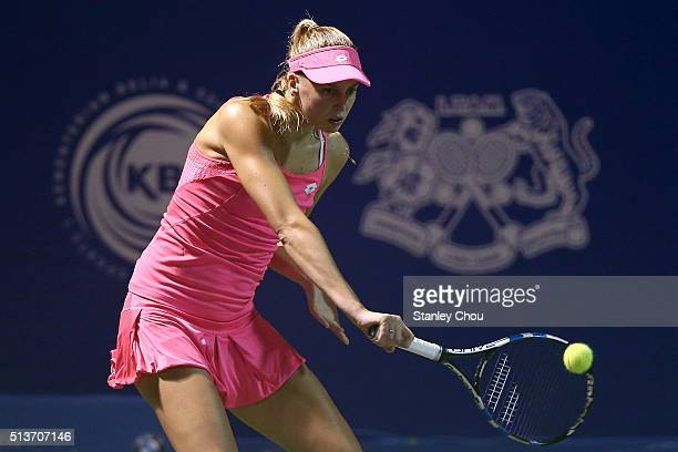Naomi Broady of Great Britain plays a backhand to Sabine Lisicki of Germany during the Quarter Finals of the 2016 BMW Malaysian Open at Kuala Lumpur...
