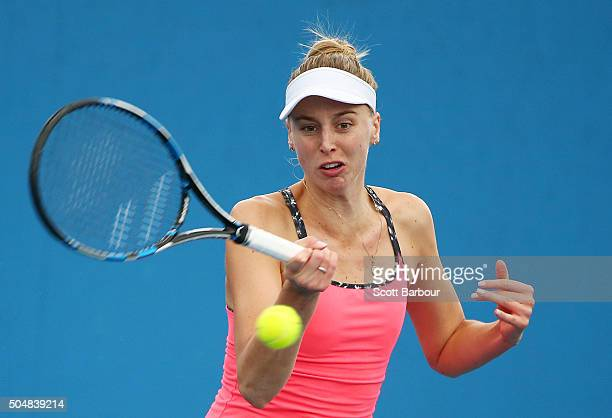 Naomi Broady of Great Britain plays a forehand in his her match against Alize Lim of France during the first round of 2016 Australian Open Qualifying...