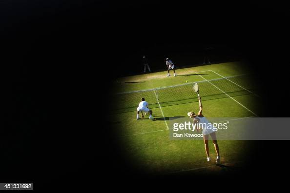 Naomi Broady of Great Britain serves during her Mixed Doubles first round match with Neal Skupski against Robert Farah of Colombia and Darija Jurak...