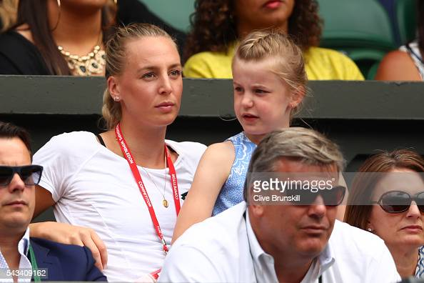 Naomi Broady watches her brother Liam Broady of Great Britain face Andy Murray of Great Britain in the Men's Singles first round match on day two of...