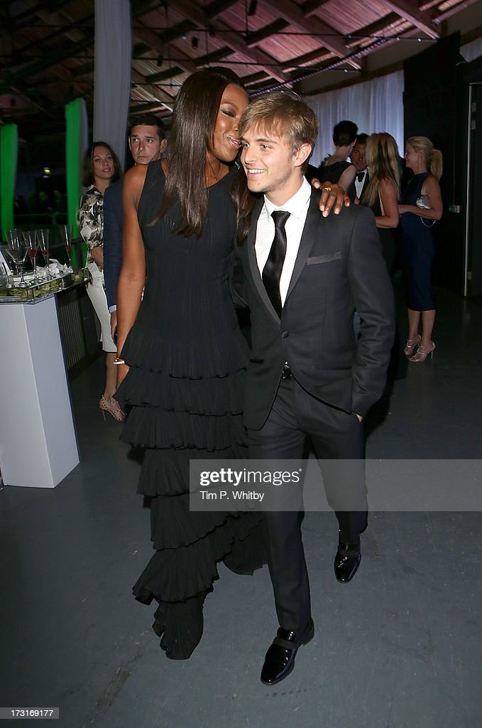 Naomi Campbell and a guest attend the Novak Djokovic Foundation inaugural London gala dinner at The Roundhouse on July 8, 2013 in London, England. The foundation supports vulnerable and disadvantaged children, especially in Djokovics native Serbia.