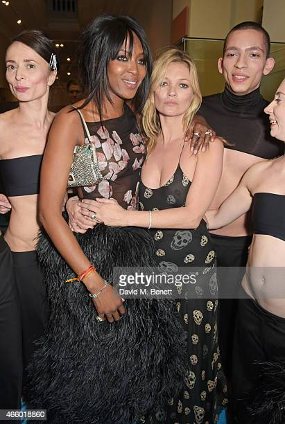 Naomi Campbell and Kate Moss pose with members of the Michael Clarke dance troupe backstage at the Alexander McQueen Savage Beauty Fashion Gala at...