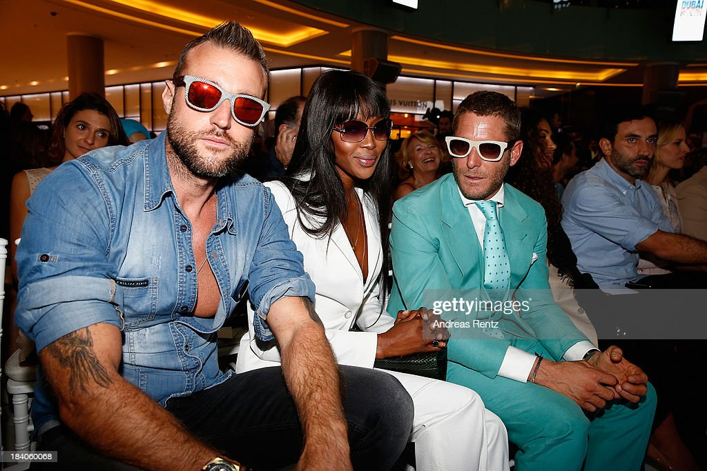<a gi-track='captionPersonalityLinkClicked' href=/galleries/search?phrase=Naomi+Campbell&family=editorial&specificpeople=171722 ng-click='$event.stopPropagation()'>Naomi Campbell</a> (C) and <a gi-track='captionPersonalityLinkClicked' href=/galleries/search?phrase=Lapo+Elkann&family=editorial&specificpeople=771607 ng-click='$event.stopPropagation()'>Lapo Elkann</a> (R) watch models walk the runway during the Vogue Fashion Dubai Experience at Dubai Mall on October 10, 2013 in Dubai, United Arab Emirates.