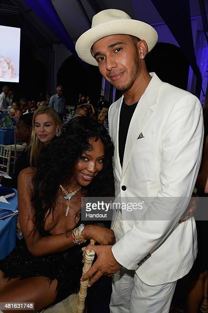 Naomi Campbell and Lewis Hamilton attend a cocktail reception during The Leonardo DiCaprio Foundation 2nd Annual SaintTropez Gala at Domaine Bertaud...