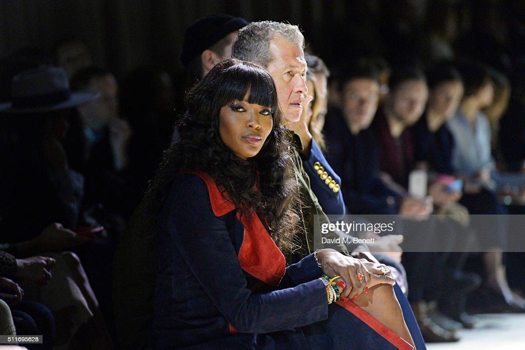 Naomi Campbell (L) and Mario Tesino wearing Burberry at the Burberry Womenswear February 2016 Show at Kensington Gardens on February 22, 2016 in London, England.