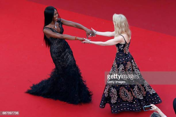 Naomi Campbell and Nicole Kidman greet each other as they attend the 70th Anniversary of the 70th annual Cannes Film Festival at Palais des Festivals...