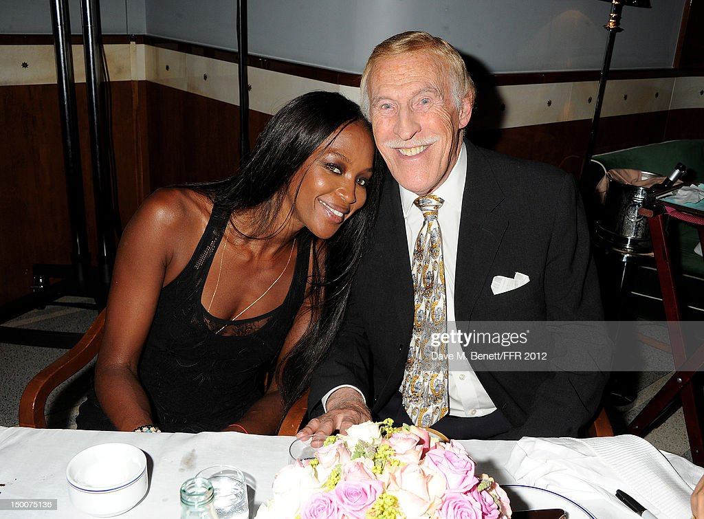 <a gi-track='captionPersonalityLinkClicked' href=/galleries/search?phrase=Naomi+Campbell&family=editorial&specificpeople=171722 ng-click='$event.stopPropagation()'>Naomi Campbell</a> (L) and Sir <a gi-track='captionPersonalityLinkClicked' href=/galleries/search?phrase=Bruce+Forsyth&family=editorial&specificpeople=158119 ng-click='$event.stopPropagation()'>Bruce Forsyth</a> attend as <a gi-track='captionPersonalityLinkClicked' href=/galleries/search?phrase=Naomi+Campbell&family=editorial&specificpeople=171722 ng-click='$event.stopPropagation()'>Naomi Campbell</a> hosts an Olympic Celebration Dinner in partnership with Fashion For Relief, Interview Magazine and Downtown Mayfair celebrating the amazing accomplishments of Team GB on August 9, 2012 in London, United Kingdom. Guest joined event hosts Naomi, Vladislav Doronin and Giuseppe Cipriani at London's Downtown Mayfair. 'The 2012 Olympics have been remarkable - I am elated for Team GB and the extraordinary success they have had so far. It's a very special and proud time to be in London and to celebrate the outstanding talent, which has been showcased during the games. I wish everyone taking part in London 2012 continued strength, determination and perseverance for the remainder of the games.'