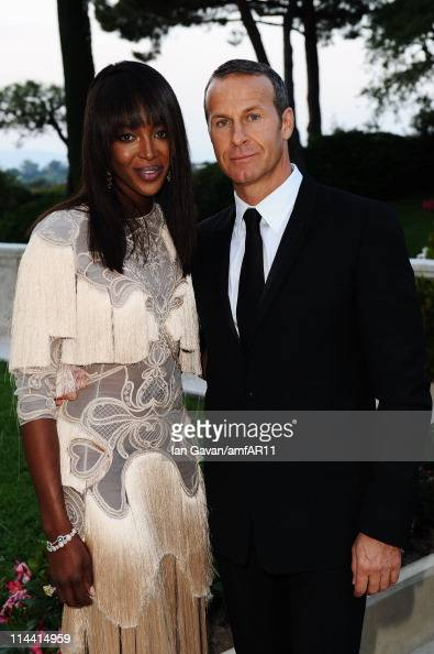 Naomi Campbell and Vladimir Doronin attend amfAR's Cinema Against AIDS Gala during the 64th Annual Cannes Film Festival at Hotel Du Cap on May 19...