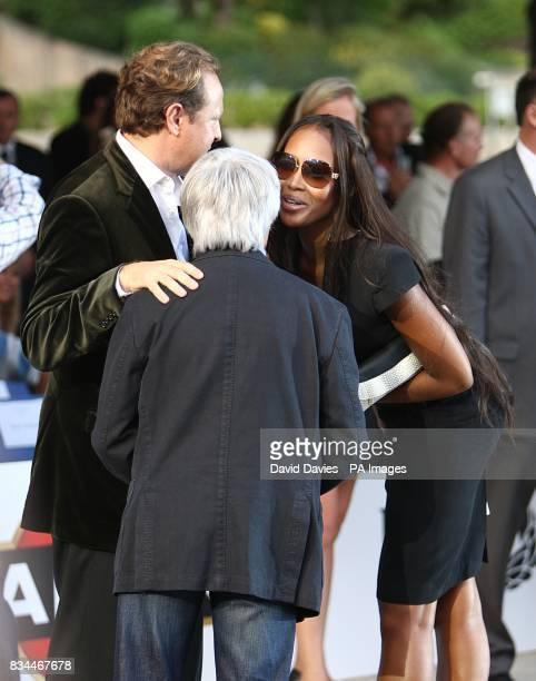 Naomi Campbell chats to Bernie Ecclestone at the Grand Prix and Fashion Unite at The Amber Lounge Le Meridien Beach Plaza Hotel Monaco