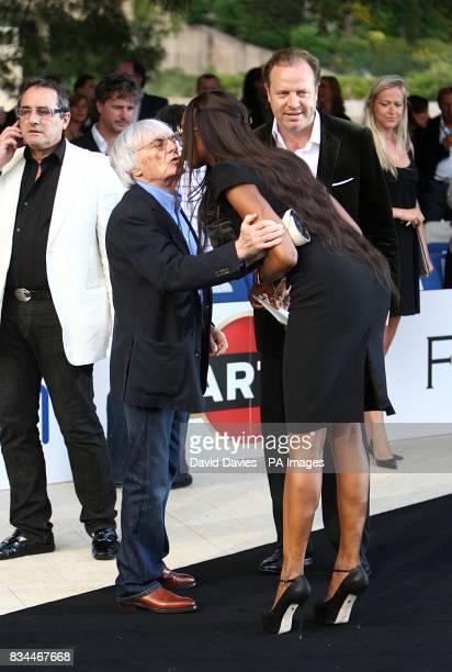 Naomi Campbell kisses Bernie Ecclestone at the Grand Prix and Fashion Unite at The Amber Lounge Le Meridien Beach Plaza Hotel Monaco