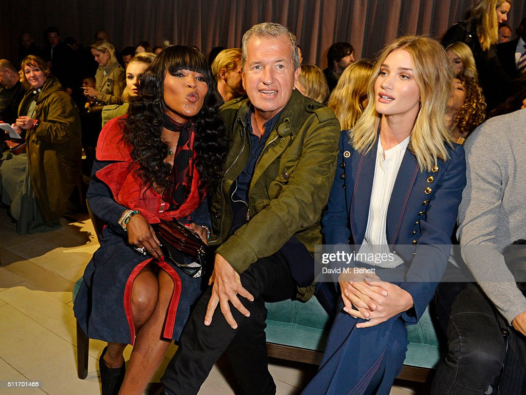 Naomi Campbell, Mario Testino and Rosie Huntington-Whiteley wearing Burberry at the Burberry Womenswear February 2016 Show at Kensington Gardens on February 22, 2016 in London, England.