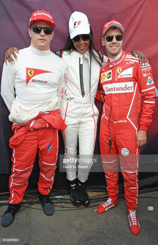 Naomi Campbell (C) poses with Ferrari racing drivers Kimi Raikkonen (L) and Sebastian Vettel backstage at F1 Live London at Trafalgar Square on July 12, 2017 in London, England. F1 Live London, the first time in Formula 1 history that all 10 teams come together outside of a race weekend to put on a show for the public in the heart of London.