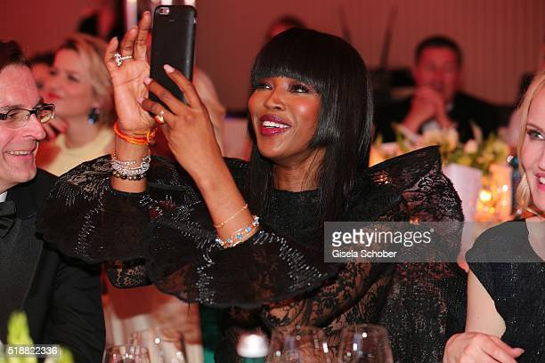 Naomi Campbell takes a photo with her phone during the Gala Spa Awards on April 2 2016 in BadenBaden Germany