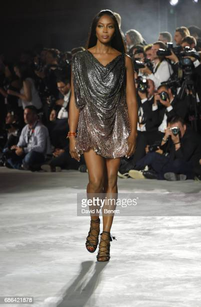 Naomi Campbell walks the runway at the Fashion for Relief event during the 70th annual Cannes Film Festival at Aeroport Cannes Mandelieu on May 21...