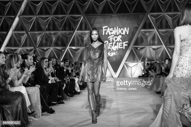 Naomie Campbell walks the runway at the Fashion for Relief event during the 70th annual Cannes Film Festival at Aeroport Cannes Mandelieu on May 21...