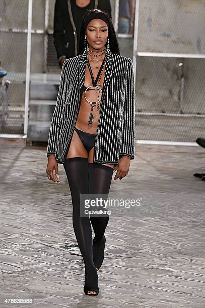 Naomi Campbell walks the runway at the Givenchy Spring Summer 2016 fashion show during Paris Menswear Fashion Week on June 26 2015 in Paris France