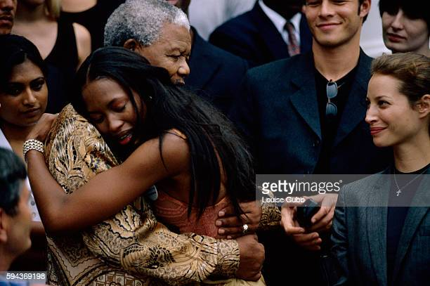 Naomi Campbell weeps with emotion as she embraces her hero Nelson Mandela Former President of South Africa and longtime political prisoner Nelson...