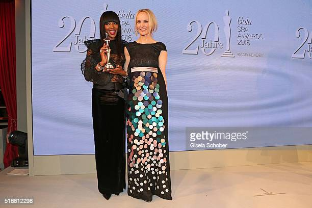 Naomi Campbell with award and Anne MeyerMinneman Editor in chief of GALA during the Gala Spa Awards on April 2 2016 in BadenBaden Germany