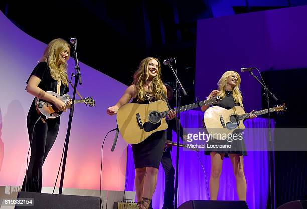 Naomi Cooke Hannah Mulholland and Jennifer Wayne of Runaway June perform onstage at the SESAC Nashville Music Awards at Country Music Hall of Fame...