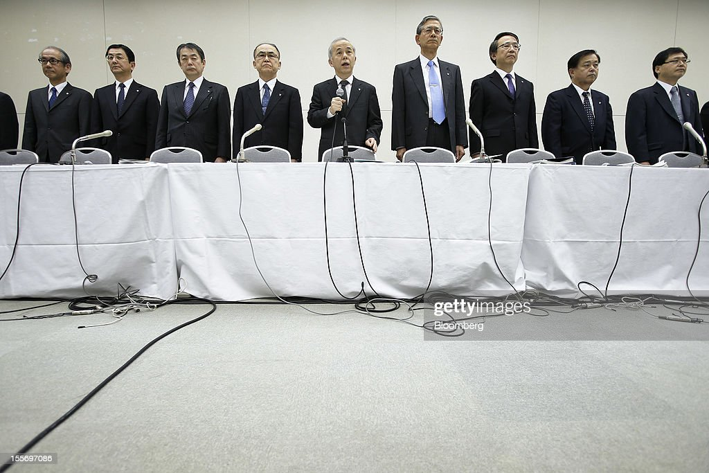 Naomi Hirose, president of Tokyo Electric Power Co. (Tepco), center, speaks during a news conference at the company's headquarters in Tokyo, Japan, on Wednesday, Nov. 7, 2012. Tepco may ask the government for more funds to cover decontamination and reactor decommissioning costs from last year's nuclear disaster at its Fukushima Dai-Ichi atomic plant. Photographer: Kiyoshi Ota/Bloomberg via Getty Images
