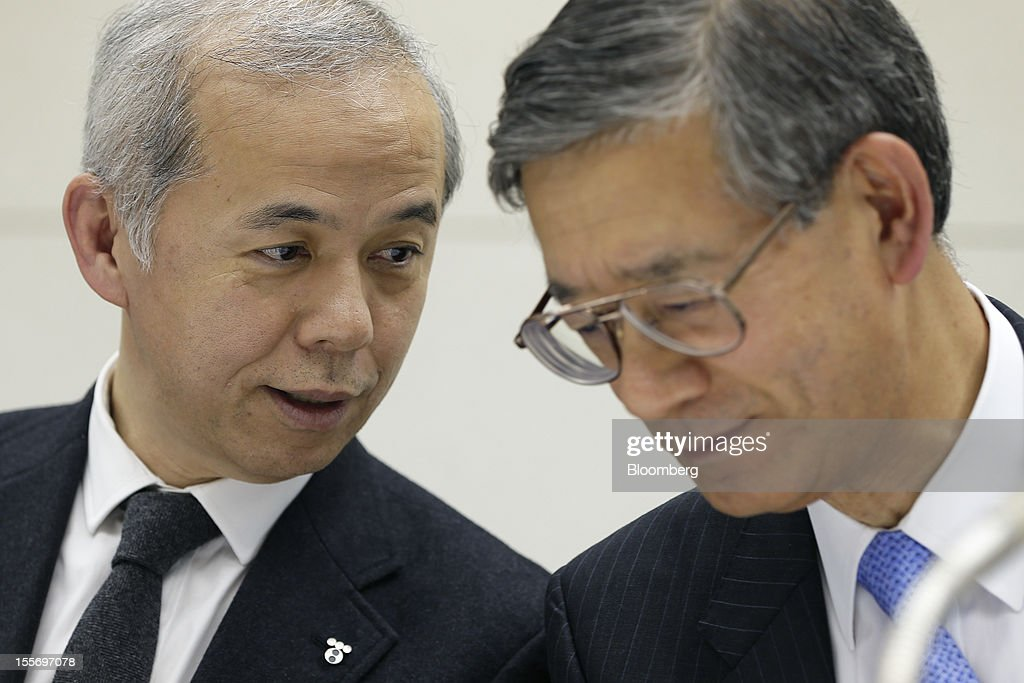 Naomi Hirose, president of Tokyo Electric Power Co. (Tepco), left, speaks with Yoshihiro Naito, executive vice president of Tepco, during a news conference at the company's headquarters in Tokyo, Japan, on Wednesday, Nov. 7, 2012. Tepco may ask the government for more funds to cover decontamination and reactor decommissioning costs from last year's nuclear disaster at its Fukushima Dai-Ichi atomic plant. Photographer: Kiyoshi Ota/Bloomberg via Getty Images