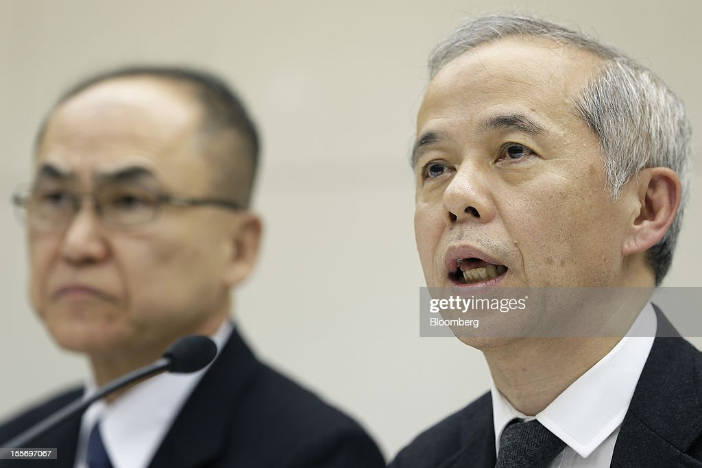 Naomi Hirose, president of Tokyo Electric Power Co. (Tepco), right, speaks as Hiroshi Yamaguchi, executive vice president of Tepco, listens during a news conference at the company's headquarters in Tokyo, Japan, on Wednesday, Nov. 7, 2012. Tepco may ask the government for more funds to cover decontamination and reactor decommissioning costs from last year's nuclear disaster at its Fukushima Dai-Ichi atomic plant. Photographer: Kiyoshi Ota/Bloomberg via Getty Images