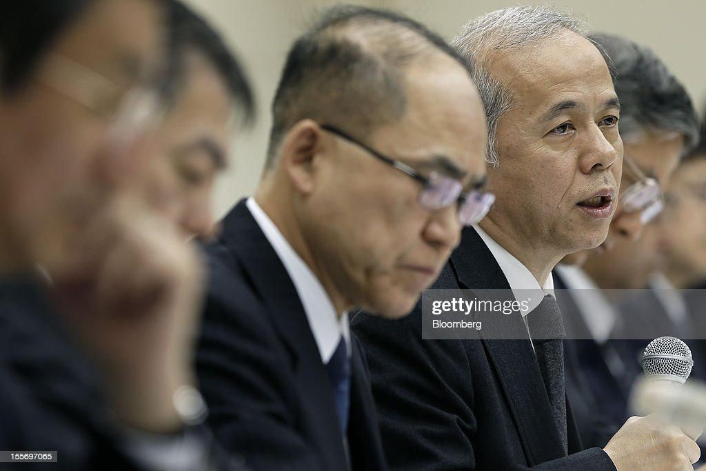 Naomi Hirose, president of Tokyo Electric Power Co. (Tepco), right, speaks during a news conference at the company's headquarters in Tokyo, Japan, on Wednesday, Nov. 7, 2012. Tepco may ask the government for more funds to cover decontamination and reactor decommissioning costs from last year's nuclear disaster at its Fukushima Dai-Ichi atomic plant. Photographer: Kiyoshi Ota/Bloomberg via Getty Images