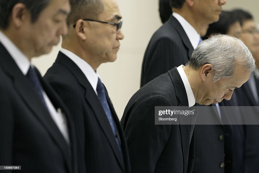 Naomi Hirose, president of Tokyo Electric Power Co. (Tepco), third from left, bows during a news conference at the company's headquarters in Tokyo, Japan, on Wednesday, Nov. 7, 2012. Tepco may ask the government for more funds to cover decontamination and reactor decommissioning costs from last year's nuclear disaster at its Fukushima Dai-Ichi atomic plant. Photographer: Kiyoshi Ota/Bloomberg via Getty Images